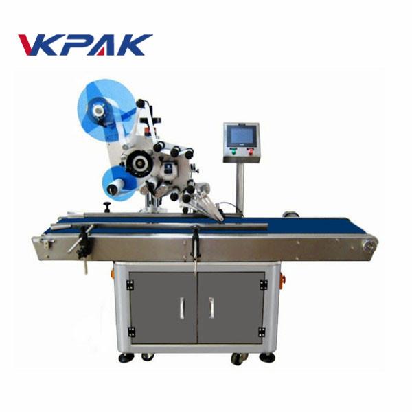 Elektrisk automatisk platt ytaetikettapplikator med insamlingsarbetsbord