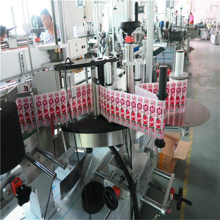 Klistermärketikettapplikator för framsidan och lindas runt etikettflaskan