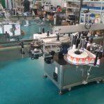 Automatisk flaskmärkning Märkningsmaskin med dubbla sidor